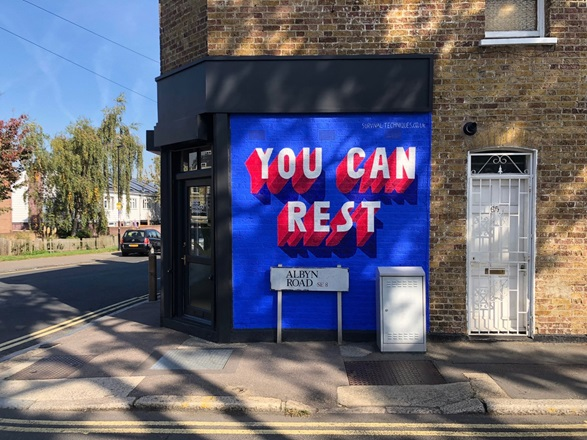 Blue wall with 'you can rest' in bold type